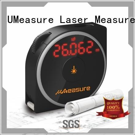 UMeasure carrying laser measuring devices backlit for worker
